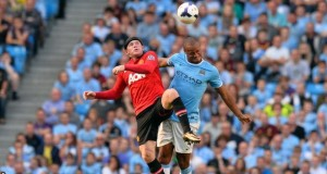 Rooney struggling it out with a City player