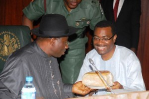 President Jonathan and Adesina with a loaf of Cassava bread