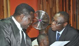 Ehindero (left) listening to his counsel, Festus Keyamo