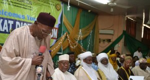 Prof. Noibi, standing, addressing other muslim leaders