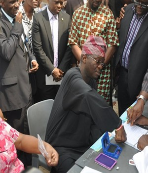 Fashola and wife during the APC membership registration exercise