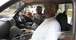 Former U.S. congressman Mel Reynolds (front) arrives at the Harare Magistrates court,
