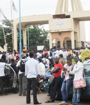 The Polytechnic, Ibadan students at the entrance of the campus