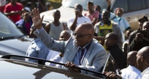 South African President Jacob Zuma greets supporters of African National Congress after voting at a voting station in the Nkandla district May 7, 2014.