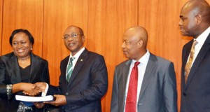 former Acting Governor, Mrs. Sarah Alade; new Governor, Mr. Godwin Emefiele; Deputy Governor, Corporate Services, Alhaji Suleiman Barau and Deputy Governor, Operations, Dr. Kingsley Moghalu, all of Central Bank of Nigeria, CBN, during the hand over to Emefiele in Abuja, yesterday