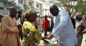Fayose distributing fowls to the people