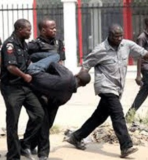 A file picture of a man arrested by police