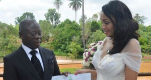 Oshiomhole and Iara Forte with the wedding certificate