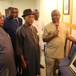 Rivers State Governor, Nyesom Ezenwo Wike restoring former Governor Sir Celestine Omehia's Portrait as former governor among the portrait of former governors at the Executive Council Chamber of Government House, Port Harcourt