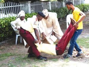 Lawal being held by colleagues