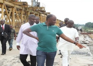 Amaechi inspecting a road project under construction while in govt