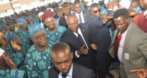 Lagos State Governor, Mr. Akinwunmi Ambode (middle) acknowledging cheers from intending pilgrims in the State during a seminar for the 2015 Hajj at the Blue Roof, LTV, Agidingbi, Ikeja, on Monday, August 17, 2015. With him are Amrul Hajj & Chairman, Adhoc Committee for 2015 Hajj, Dr. Abdul Hakeem Abdul Lateef (left, behind) and member of the Committee, Alhaji Monsur Olowosago (left).