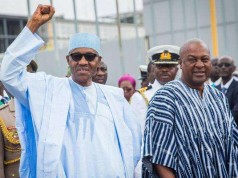 Buhari acknowledging cheers on arrival in Accra