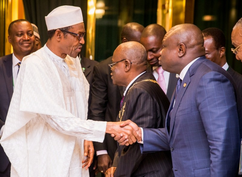 Lagos State Governor, Mr. Akinwunmi Ambode (right) in a warm handshake with President Muhammadu Buhari (left) during a courtesy visit to the President by ICAN council members at the Aso Villa, Abuja