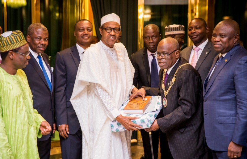 President, Institute of Chartered Accountants of Nigeria, ICAN, Otunba Samuel Olufemi Deru (2nd right), presenting a souvenir to President Muhammadu Buhari (2nd left), Ogun State Governor, Senator Ibikunle Amosun (left, behind) during a courtesy visit to the President by ICAN council members at the Aso Villa, Abuja on Tuesday