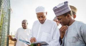 Buhari and Son in his farm