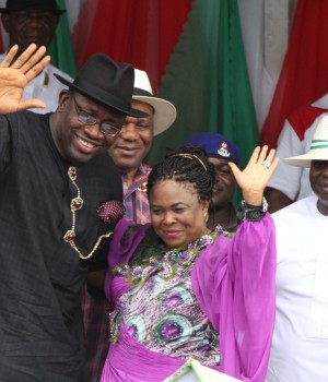 Governor of Bayelsa State, Hon. Seriake Dickson (left) accompanied by the former 1st lady, Dame Patience Jonathan (centre) acknowledging cheers from the mammoth crowd on their arrival during the Governor's declaration for 2nd term in office, at the Samson Siasia Sports Complex in Yenagoa, while the 1st Civilian Governor of the State, Chief Diepreye Alamieyeseigha (right) looks on in Yenagoa today (Tuesday) September 8 2015