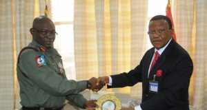 General Olonisakin presenting a souvenir to the Chairman of the delegation