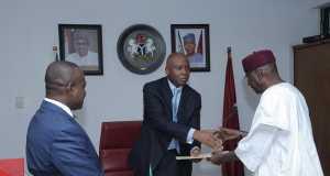 Senate President Bukola Saraki receiving the Ministerial List in his office