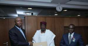Senate President Bukola Saraki receiving the Ministerial List in his office