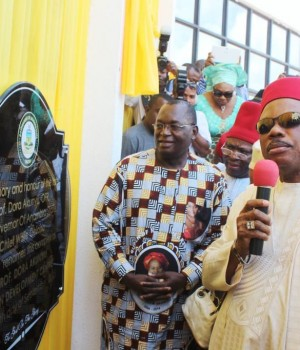 Dr. Chike Akunyili, widower of the late Minister of Information and Chief Willie Obiano, Governor of Anambra State unveiling a plaque to commemorate the renaming of the Women Development Center, Awka to Professor Dora Akunyili Women Development Center, Awka.
