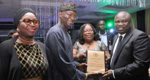 R-L : Lagos State Governor, Mr. Akinwunmi Ambode, with the Chief Judge of Lagos State, Hon. Justice Olufunmilayo Atilade, jointly presenting an award of Excellence to the former Lagos State Governor, Mr. Babatunde Fashola, SAN, during the 2015/2016 Legal Year Dinner, at the Law School, Victoria Island, Lagos, on Friday, October 2, 2015. With them is Hon. Justice Toyin Oyekan-Abdullai