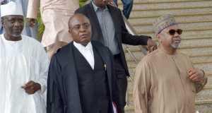 Former Ngeria's National Security Adviser, Col.Sambo Dasuki(right), hisCounsel to Sambo Dasuki, Ahmed Raji and Former governor of Sokoto State, Alhaji Attahiru Baffarawa at the Federal High Court in Abuja