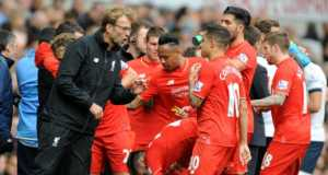 Liverpool manager Juergen Klopp talks to players during the English Premier League soccer match between Tottenham Hotspur and Liverpool at the White Hart Lane, London, England, Saturday, Oct. 17, 2015.