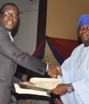 PIX 0215: Lagos State Governor, Mr. Akinwunmi Ambode (right) congratulating Mr. Steve Ayorinde, after being sworn in as Commissioner for Information & Strategy, at the Adeyemi Bero Auditorium, the Secretariat, Alausa, Ikeja, on Monday, October19, 2015.