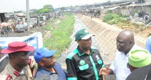 Lagos State Governor, Mr. Akinwunmi Ambode; Secretary to the State Government, Mr. Tunji Bello; Commissioner for the Environment; Dr. Babatunde Adejare and Sector Commander, Federal Road Safety Corps, Lagos, Mr. Hyginus Omeje, during the Governor's inspection of Ladipo Canal beside Guardian Newspapers Limited, on Tuesday,