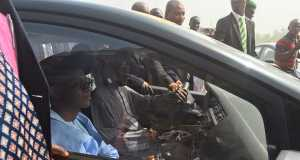 Tinubu-El-Rufai driving one of the taxi cabs