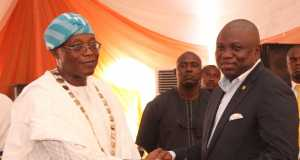Lagos State Governor, Mr. Akinwunmi Ambode (right), receiving the Best State Pavilion Award from President, Lagos State Chambers of Commerce & Industry (LCCI), Alhaji Remi Bello, during the closing ceremony of the 2015 International Trade Fair, at the Tafawa Balewa Square, Lagos, on Sunday,