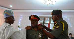 L-R: Oyo State Governor, Senator Abiola Ajimobi; Brig.-Gen. Clement Apere; and General Officer Commanding, 2 Division, Nigerian Army, Ibadan, Maj.-Gen. Laz Ilo, during the decoration of newly-promoted officers at the Army Officers' Mess, Ibadan,