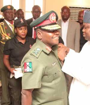 Lagos State Governor, Mr. Akinwunmi Ambode (right); decorating Commander, 9 Mechanized Brigade, Brigadier General Ahmed Mohammed Sabo (left), during the Launching of the Year 2016 Armed Forces Remembrance Emblem Appeal, at the Lagos House, Marina, on Wednesday
