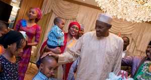 President Buhari admiring a young boy during his birthday in Abuja