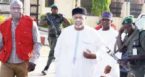 Dasuki Sambo being led into the court room by EFCC operatives