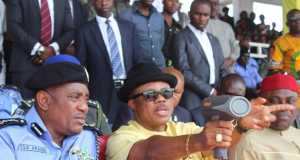 Chief Willie Obiano, Governor of Anambra State (M) demonstrating the use of a Speed Gun during the presentation of 25 purpose-built patrol cars, Speed Guns and Alcohol Detectors to the Police in Awka on Friday. With him are Solomon Arase, the Inspector General of Police (L) and Chief Victor Ike Oye, National Chairman of APGA