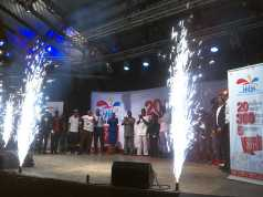 Guests stand in applause as fireworks herald the One Lagos Fiesta at Freedom Park