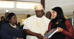 Lagos State Governor, Mr. Akinwunmi Ambode (middle); receiving the Lagos State Laws from the Managing Director, Thomson Reuters Africa, Sneha Shah (right), during the formal handing over at the Adeyemi Bero Auditorium, Alausa, Ikeja, on Tuesday, December 08, 2015. With them is the Deputy Governor, Dr. (Mrs.) Oluranti Adebule.