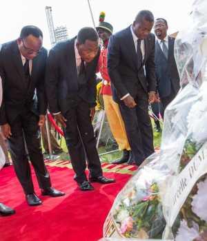 President Buhari and others at the burial rites of Mathieu Kerekou