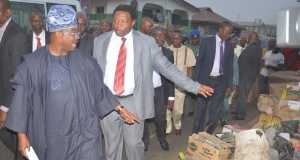 L-R: Oyo State Governor, Senator Abiola Ajimobi; and Head of Local Government Administration, Mr. Akintomide Akinpelu, during the governor's inspection tour of major roads and markets, during when he frowned upon late evacuation of mounting refuse on the median strips... on Tuesday.
