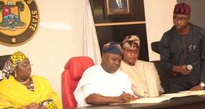 Lagos State Governor, Mr. Akinwunmi Ambode (2nd right), signing the Employment Trust Fund (ETF) Bill and the Lagos State University (LASU) Bill into Law, while Deputy Governor, Dr. (Mrs.) Oluranti Adebule (left); Deputy Speaker, Lagos State House of Assembly, Hon. Wasiu Sanni Eshinlokun (2nd right) and Special Adviser on Civic Engagement to the Governor, Mr. Kehinde Joseph (right), watch, during the Signing of the Bills into Law, at the Conference room, Lagos House, Ikeja, on Tuesday,