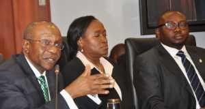 L-R The new CBN Governor, Godwin Emefiele, CBN Deputy Governor Monetary Policy Serah Alade and Deputy Governor Financial System Stability, Adebayo Adelabu ...