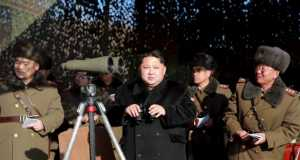 North Korean leader Kim Jong Un (C) watches a firing contest of the KPA artillery units at undisclosed location