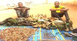 Arrested soldiers with military equipment recovered from them