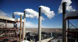 Steam rises from the stakes of the coal-fired Jim Bridger Power Plant outside Point of the Rocks, Wyoming,