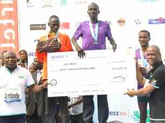 L-R: Lagos State Governor, Mr. Akinwunmi Ambode (left); Group Managing Director, Access Bank, Mr. Herbert Wigwe (right), jointly presenting a cheque of $50, 000 to the 1st Prize Winner of the Lagos City Marathon, Abraham Kiptom from Kenya, while the 2nd Prize Winner, Hosea Kipkemboi from Kenya and the 3rd Prize Winner, Debebe Kolosa from Ethiopia, watch, during the Lagos City Marathon at the Eko Atlantic City, Lagos, on Saturday