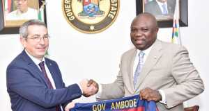 Lagos State Governor, Mr. Akinwunmi Ambode (right), being presented with a jersey of FC Barcelona of Spain by the Board member of the Club, Pau Vilanova i Vila Abadal, during a courtesy visit to the Governor, at the Lagos House, Ikeja, on Monday