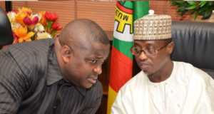 (L-R) Senate Committee Chairman on Gas, Senator Bassey Albert Akpan conferring with the Group Executive Director Exploration and Production of the NNPC, Dr. Maikanti Baru, when the Senate Committee on Gas paid an oversight visit to the Nigerian National Petroleum Corporation Towers in Abuja, Monday.