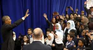 Obama waves farewell to students after his remarks at the Islamic Society of Baltimore mosque in Catonsville, Maryland